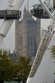 Great photo perspective of one of Europes lovely old cathedrals, being framed in this camera shot by foreground architecture. Photographed from the London Eye. -DdO:) http://www.pinterest.com/DianaDeeOsborne/intriguing-architecture