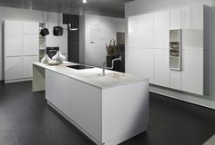 Stainess steel cabinets by Alno in frosted white.