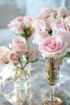 Pink roses in vintage champagne flutes!