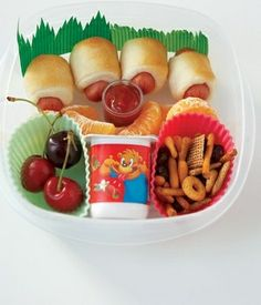 Here's a some pint-sized bento box ideas for kids - mini hotdog rolls with ketchup, clementine slices, cherries, cup of yogurt and snack mix with raisins. Yum! What a fun bento combo for little kids! For more creative ideas for kids lunches visit www.facebook.com/... you may find something you 'LIKE'