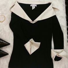 """White House Black Market Top * Holiday Price!!! This Amazing top is 21"""" long from shoulders. 92% rayon & 8% spandex. Has beautiful pearls on the cuffs. Is in really good condition. White House Black Market Tops Blouses"""