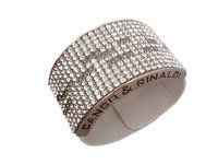 White-silverish Cango & Rinaldi bangle with over 300 Swarovski crystals is here. It has been a huge hit everywhere it has been seen in Europe and North America including Hollywood and Las Vegas.    Now this beautiful white-silverish leather bracelet is available for you as well with deliveries everywhere in the world. Choose the most fascinating bracelet which has over 300 beautiful and high quality Swarovski crystals on it. This bracelet can be worn on weekday and on festivities as well.