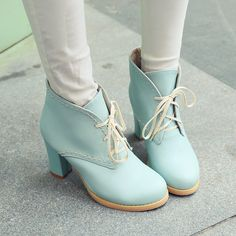 Adorable Pastel Blue Lace up Chunky Heel Boots! the look cute with a vintage dress . now you look like a vintage doll :)
