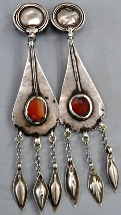 My favorite Turkmen earrings   silver long pear shapes with carnelian and Indian tops (designed by Linda Pastorino)