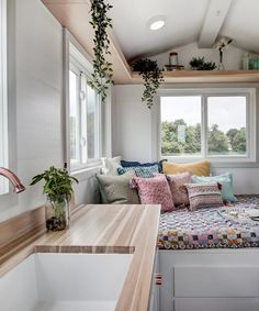 """Packed in the Nugget is a main floor sleeping area, bathroom with composting toilet and 30""""x30"""" shower, and kitchen."""