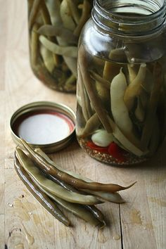 Spicy Pickled Beans using chile pepper, fresh dill, garlic, mustard seeds, fennel seeds, and dill seeds.