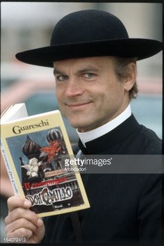 The Italian actor Terence Hill, in the role of Don Camillo, holding the novel by Giovannino Guareschi that inspired the character he played. Italy, 1983.