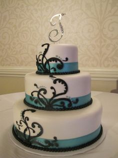 Teal ribbon wedding cake with black scrollwork