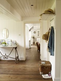 casual entry with beadboard, iron table, plank floor