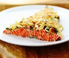 Baked wild salmon with lemon, parsley and almonds