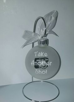 Do you have a photographer in the family? Celebrate their ability to capture timeless moments with this Christmas bulb, personalized with one of the three saying pictured, or a phrase of your own. Their name can also be added to the back or the year. Bulb is 3.25 inches and frosted glass. Vinyl decal is designed and cut with my machine using high quality indoor vinyl. Be sure when checking out to include any personalization and which saying you would like in the notes to seller section.