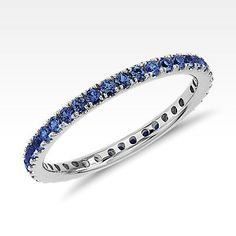 This sapphire eternity ring features a petite row of deep blue gemstones set in 18k white gold.