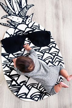 """Yolo Kidz Pineapple Play Blanket.  Liven your kidz room with this life-size (56""""x24"""") pineapple play blanket that will become the centerpiece of any room.  Made from organic cotton, it is not only beautiful and soft but safe against your little one's skin.  Filled with eco-friendly batting this blanket will not only be beautiful in your home but also beautiful to the environment."""
