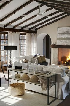 white slipcovers + reclaimed wood beams