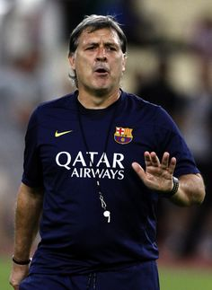 Gerardo Martino coach of Barcelona FC reacts during a Barcelona FC training session at Bukit Jalil National Stadium on August 9, 2013 in Kuala Lumpur, Malaysia.