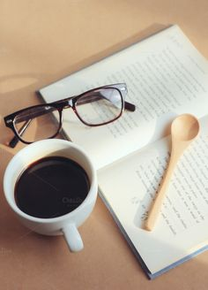 eyeglasses and book with coffee by Nuchylee Photo on Creative Market