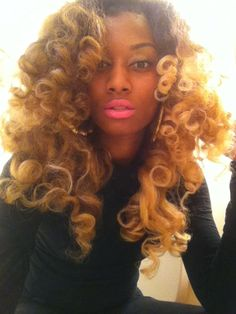 Chinese Kinky Curly 22,24,and 26 Inches.  Hair has been bleached and Curled using Flexirods