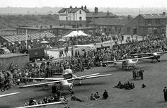 1951 view of Barton Aerodrome's 1930s buildings including the Airport Hotel and farm buildings converted for passenger use. Also wartime temporary structures, now demolished.