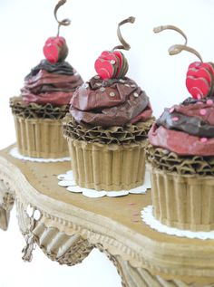 """The Cardboard Kitchen"" Chocolate Cupcakes With Chocolate Buttercream, Cherries, And Sprinkles On A Shelf SOLD*** Food Sculpture, Cardboard Sculpture, Cardboard Crafts, Cardboard Kitchen, Chocolate Buttercream, Chocolate Cupcakes, Chocolate Sprinkles, Paper Cake, Cake Art"
