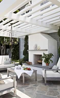 Stunning Stone Patio! Terrific pergola. Tim Barber Architect.
