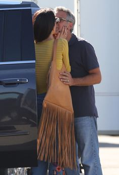 George and Amal Clooney Steal a Few Kisses on the Set of His New Movie