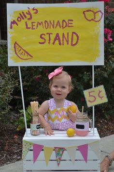 1st birthday lemonade stand party. Used crate and sticks from Joanns and painted the sticks white and made poster and banner. Very easy!
