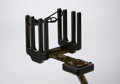 Rack your wakeboard, waterskis, wakeskate, kiteboards, wakesurf boards or skim boards on your boat that integrates in with your rod holders. Camouflage rack.
