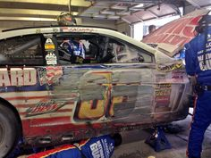 After hitting the wall during the race at Texas. The Dale Earnhardt Jr's team asset the damage to the car.