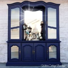 Revive an estate sale hutch with a bold navy blue paint job.