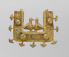 Earrings and Pendant  Object Name: Pendant Date: 11th–12th century Geography: Iran Medium: Gold; filigree and granulation Dimensions: Max. diam. 2 5/16 in. (5.9 cm) Classification: Jewelry Credit Line: Purchase, Shamina Talyarkhan Gift, 2007
