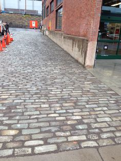 The finished product! A Belgian block driveway period correct to match the refurbished commercial building.