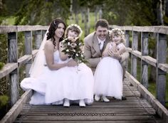 The bride and groom with their lovely little flower girls pose for a memorable picture. barossa photo company, wedding photography  www.barossaphotocompany.com.au