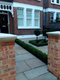 Imperial red brick London wall stone pier caps sandstone paving and formal topiary classic front garden Balham Sandstone Paving, Brick Paving, Concrete Patio, Patio Wall, Backyard Patio, Victorian Front Garden, Front Garden Landscape, Garden Landscaping