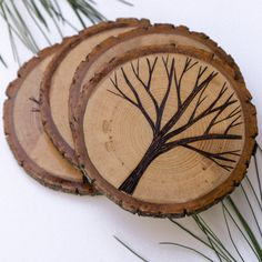 Set of 4 Rustic Wood Slice Coasters with Wood Burned Tree Designs on Etsy, $35.00