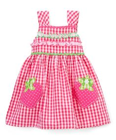 This vintage sleeveless dress features a classic gingham look sweetened with a cheerful strawberry appliqué. An oh-so-comfy cotton blend provides a soft feel.