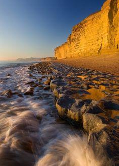 Golden cliffs & incoming tide , Burton Bradstock, Dorset, UK