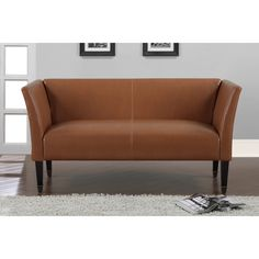 This stylish, bonded leather Marcella sofa is a must-have for completing any room. With bronze-capped, espresso-finished wood legs and curved arms, the loveseat is sure to add flair to your home decor.