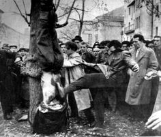 Rebels mutilate the body of an ÁVH member lynched outside the Communist Party Headquarters during the Hungarian Revolution, October 30th, 1956 via GK Zhukov's Military History Emporium.