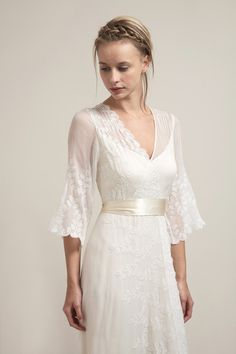 """For a truly bohemian bride, this 3/4"""" sleeves silk chiffon dress has original leaf embroidery that will mesmerize. The embroidery is placed diagonally around the front and back bodices creating intere"""