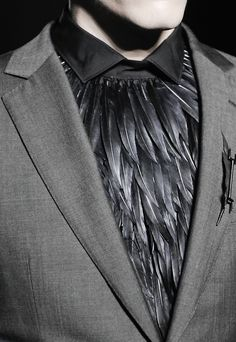 Feathered shirt - The purpose of a steampunk outfit is to engage the senses, and to show creativity, and whimsy. This does so, while also clearly understanding the Victorian lines, and gently teasing the cravat, and the well feathered men of the upper class.