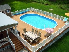 I love this. Only thing I would add is a slide and a gate to keep dogs out. Oval above ground swimming pools with wooden decks and white railing