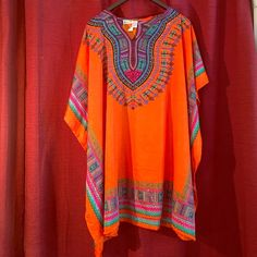sante kimoda orange brand new  New inventory orange kimoda short great looking on. And nice free style fit 100 percent poly.  Just came in from Florida sorry brand new firm price Sante Dresses