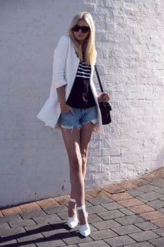 this effortless combo relies on a white blazer and basic cutoffs