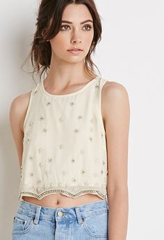 Buy it now. FOREVER21 Women's  Embellished Chiffon Crop Top. With embellishment in the form of rhinestones, faux pearls, and petite beads on its front and tracing its scalloped hem and buttoned split back, this top is full of vintage charm. Though it has a refined look, its cropped cut and sleeveless design lend it a relaxed touch that'll fit in with any collection of free-spirited pieces. Semi-sheer, partially linedLightweight, wovenShell: 100% rayon; Lining: 100% polyester17%22 full…