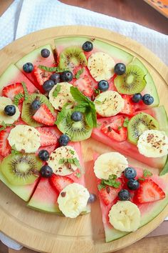 This healthy Watermelon Pizza topped with fresh berries, sliced banana, kiwi fruit, creamy passionfruit yoghurt and grated chocolate is the perfect kid-friendly treat.