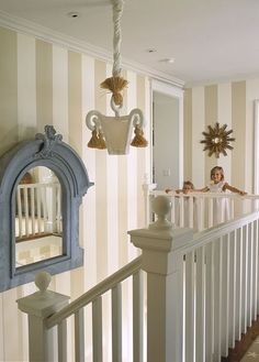 Draw attention to the height of a two story stairwell by painting it with vertical stripes.