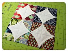 "A Stellar Block - Quilting In The Rain --  This block is a different take on the cathedral window design and uses only charm squares (pre-cut 5"" squares)."
