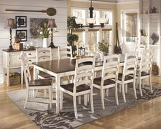 """With the warm two-tone look of the cottage white and burnished brown finishes beautifully accenting the stylish cottage design, the """"Whitesburg"""" dining collection creates an inviting cottage retreat within the décor of any dining room."""