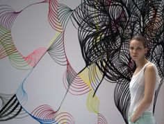Andrea Maack herself with Coal drawing