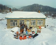 Chinese photographer Huang Qingjun has spent nearly 10 years travelling to remote areas in China to convince people to have their picture taken along with all of their possessions.